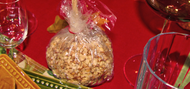 Caramel Apple Covered in Peanuts Table setting for autumn equinox Holiday & Hearth Holiday and Hearth Lisa Novelline Lisa Anne Novelline author writer The Dance of Spring craft blog creative blog creativity decorator blog festival celebration summer seasons nature blog Mabon Autumn Equinox Harvest Season Season of the Witch September Thanksgiving tablecloth red apples cornucopia autumn lollipops maple sugar candy
