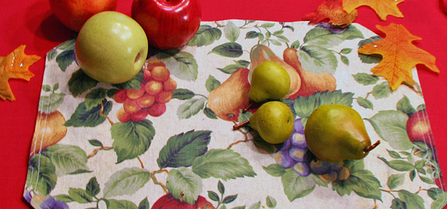 Autumn Equinox Table Placemat Table setting for autumn equinox Holiday & Hearth Holiday and Hearth Lisa Novelline Lisa Anne Novelline author writer The Dance of Spring craft blog creative blog creativity decorator blog festival celebration summer seasons nature blog Mabon Autumn Equinox Harvest Season Season of the Witch September Thanksgiving tablecloth red apples cornucopia autumn lollipops maple sugar candy